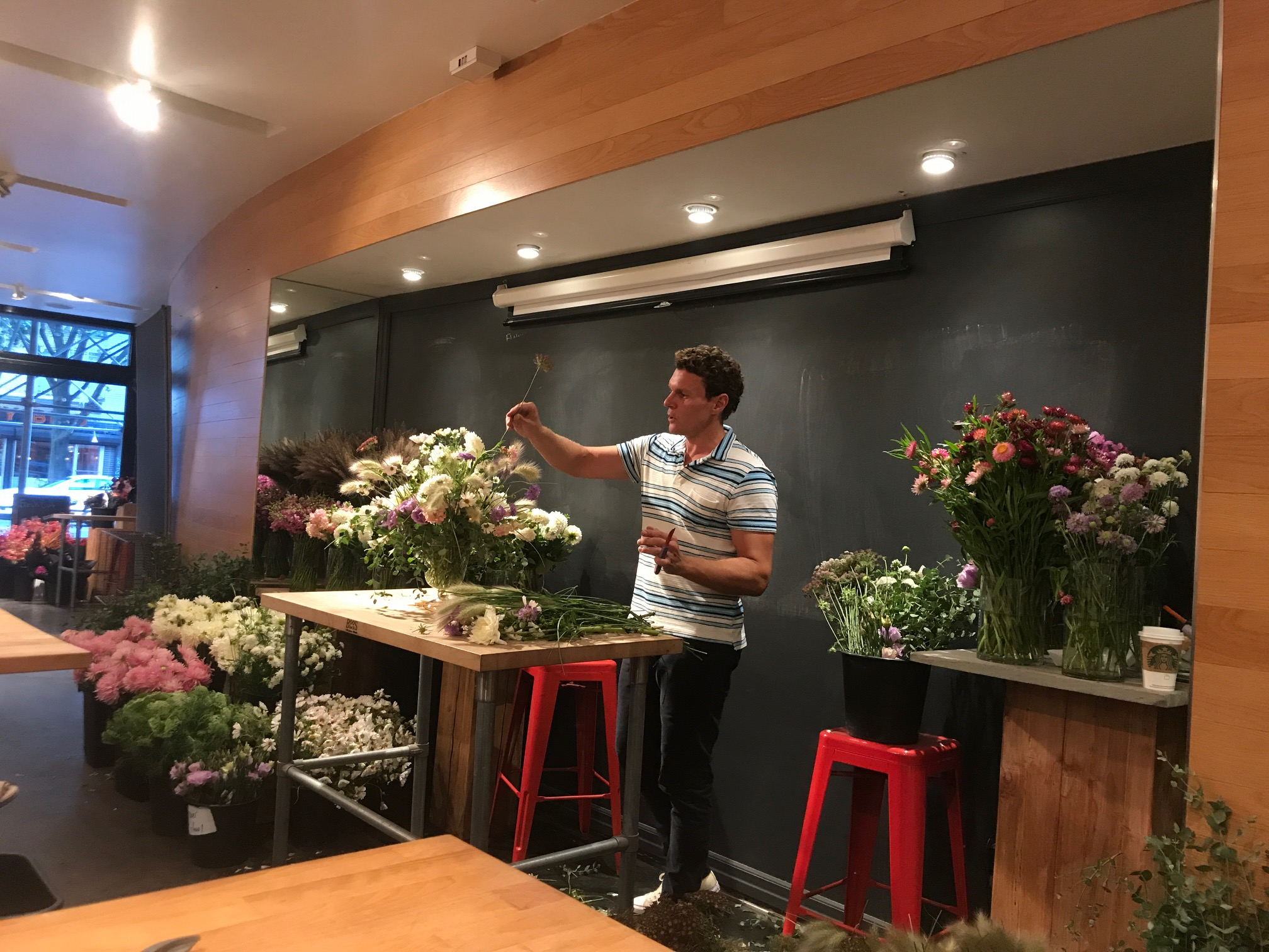 Lewis Miller working on his demonstration arrangement. The strawflowers at right are from our farm.