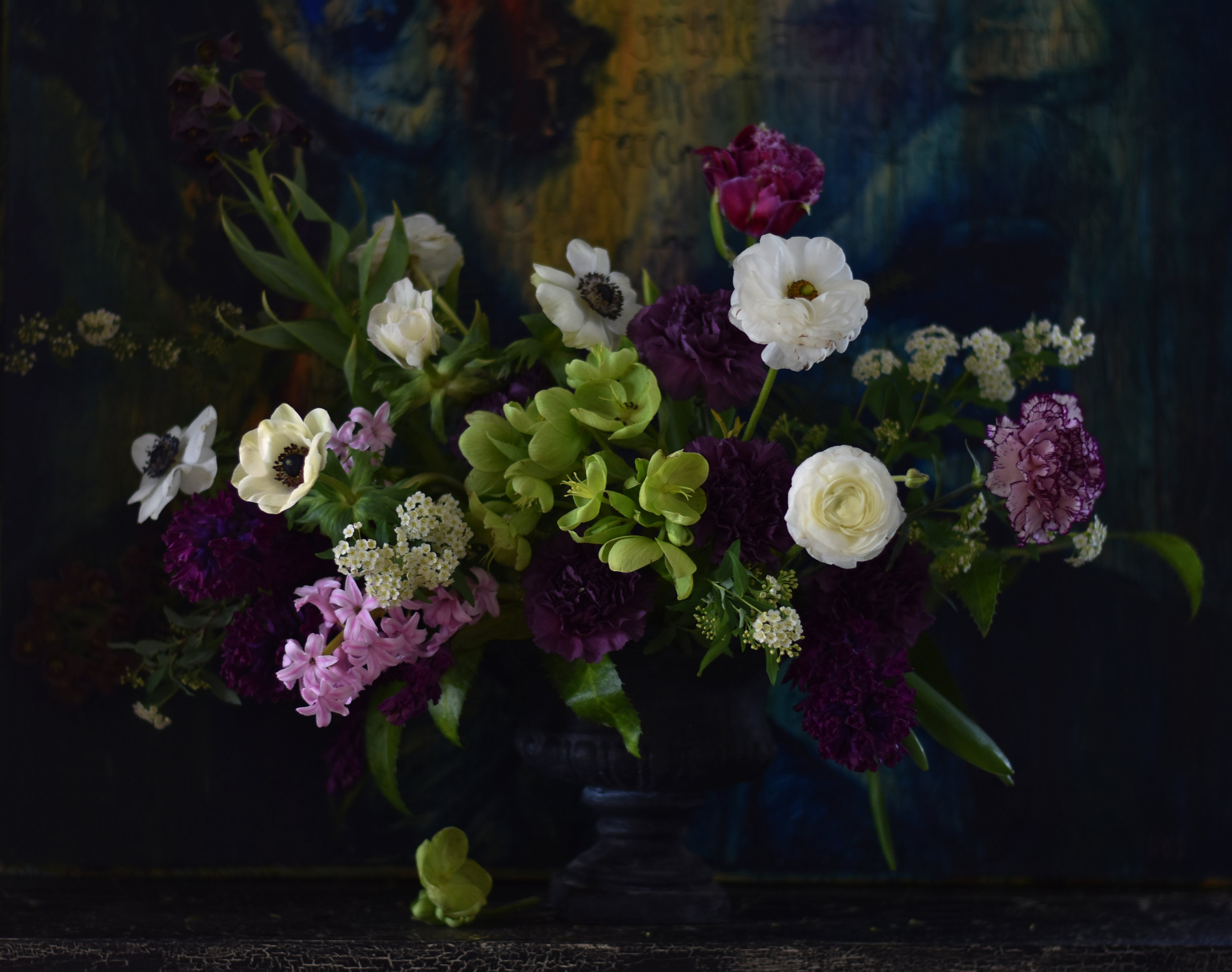 """My own take: A spring design shot in the """"Dutch master style"""" in front of one of my over-sized mixed media portraits. I love the light on the anemones and how elements like the spirea at left fade right into the canvas."""