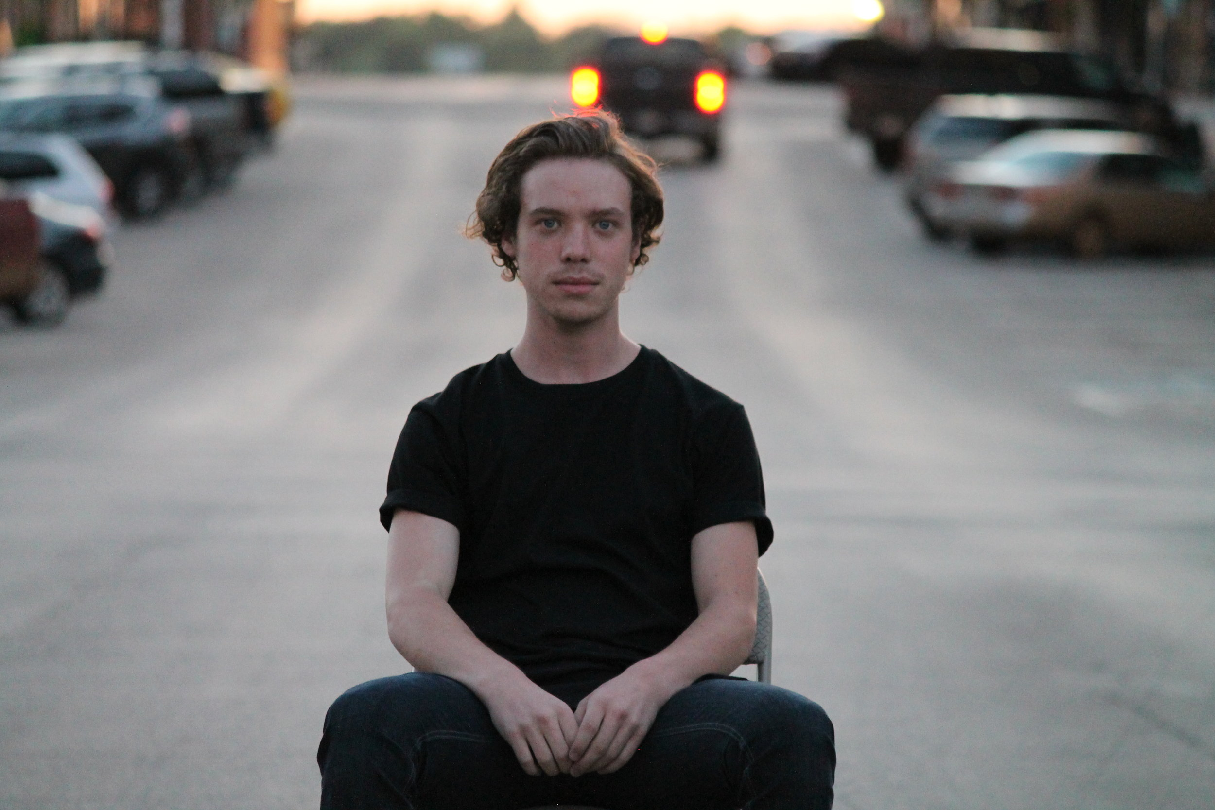 young man in street in downtown guthrie.JPG