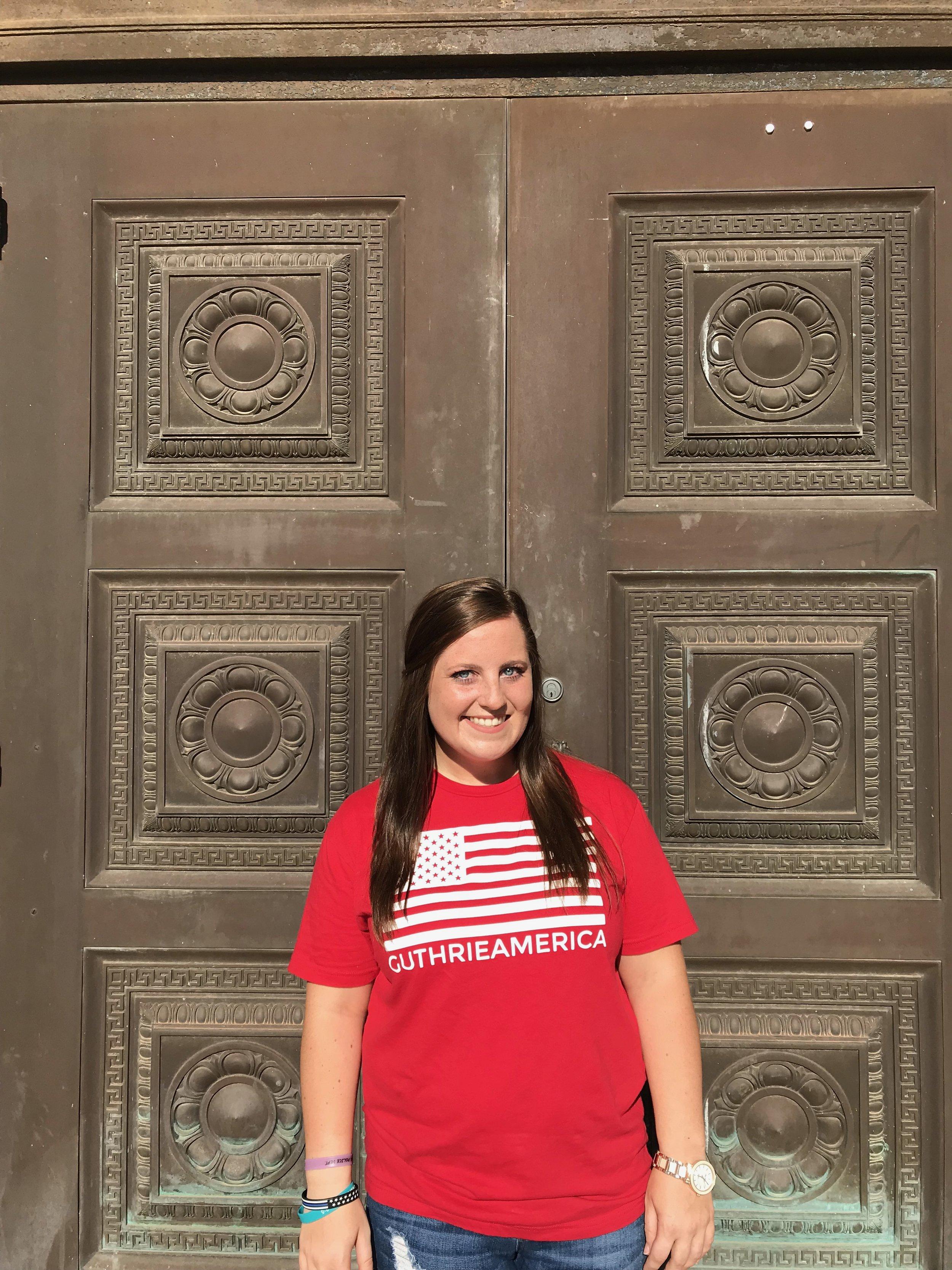 mollie Swartzbaugh at temple in guthrie in a guthrie america tee.jpg