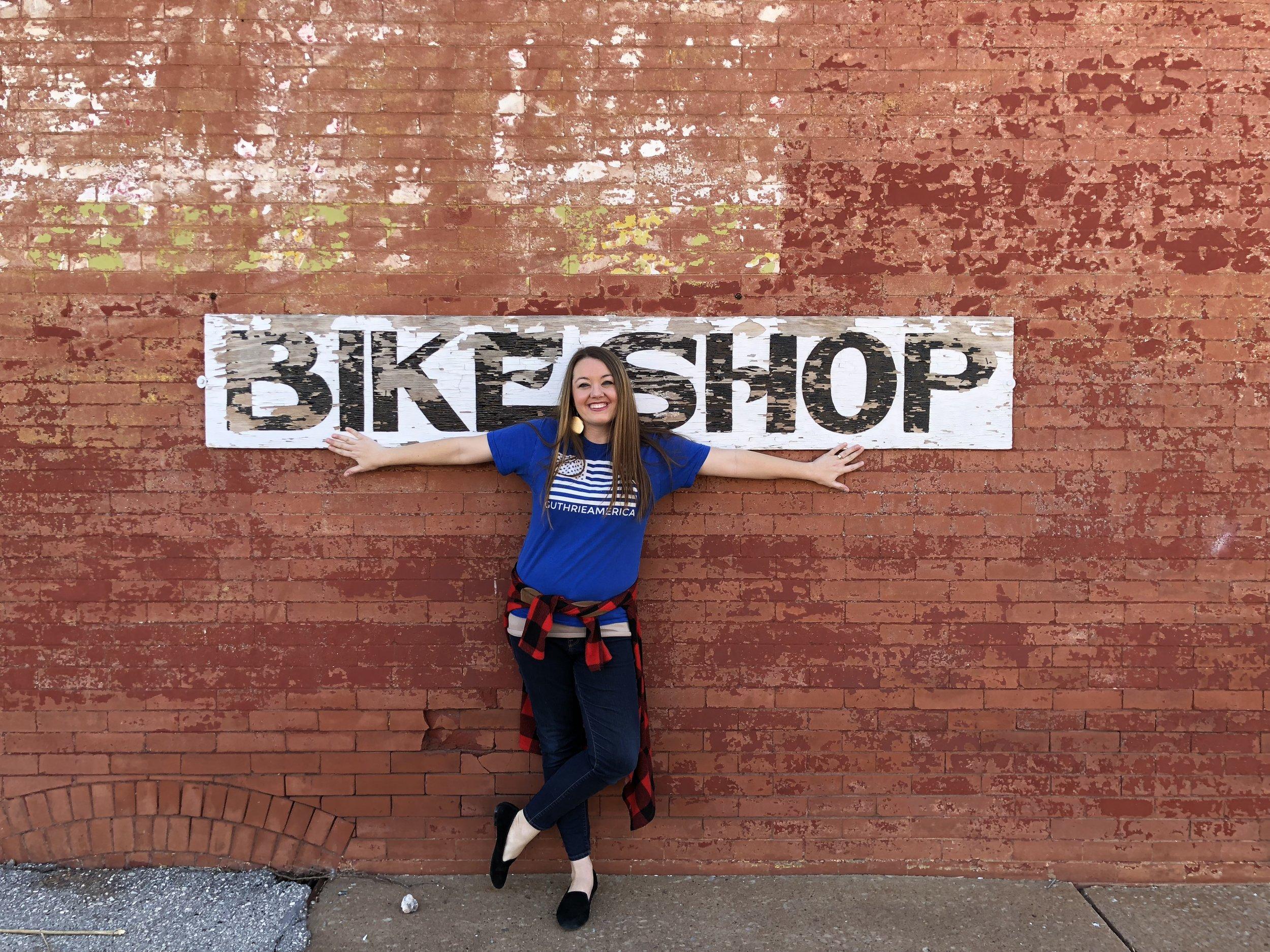 Courtney on bike shop wall.