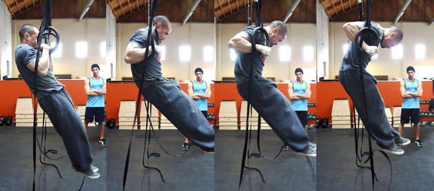 The strict muscle-up is performed with the legs out straight and in front of the rings.