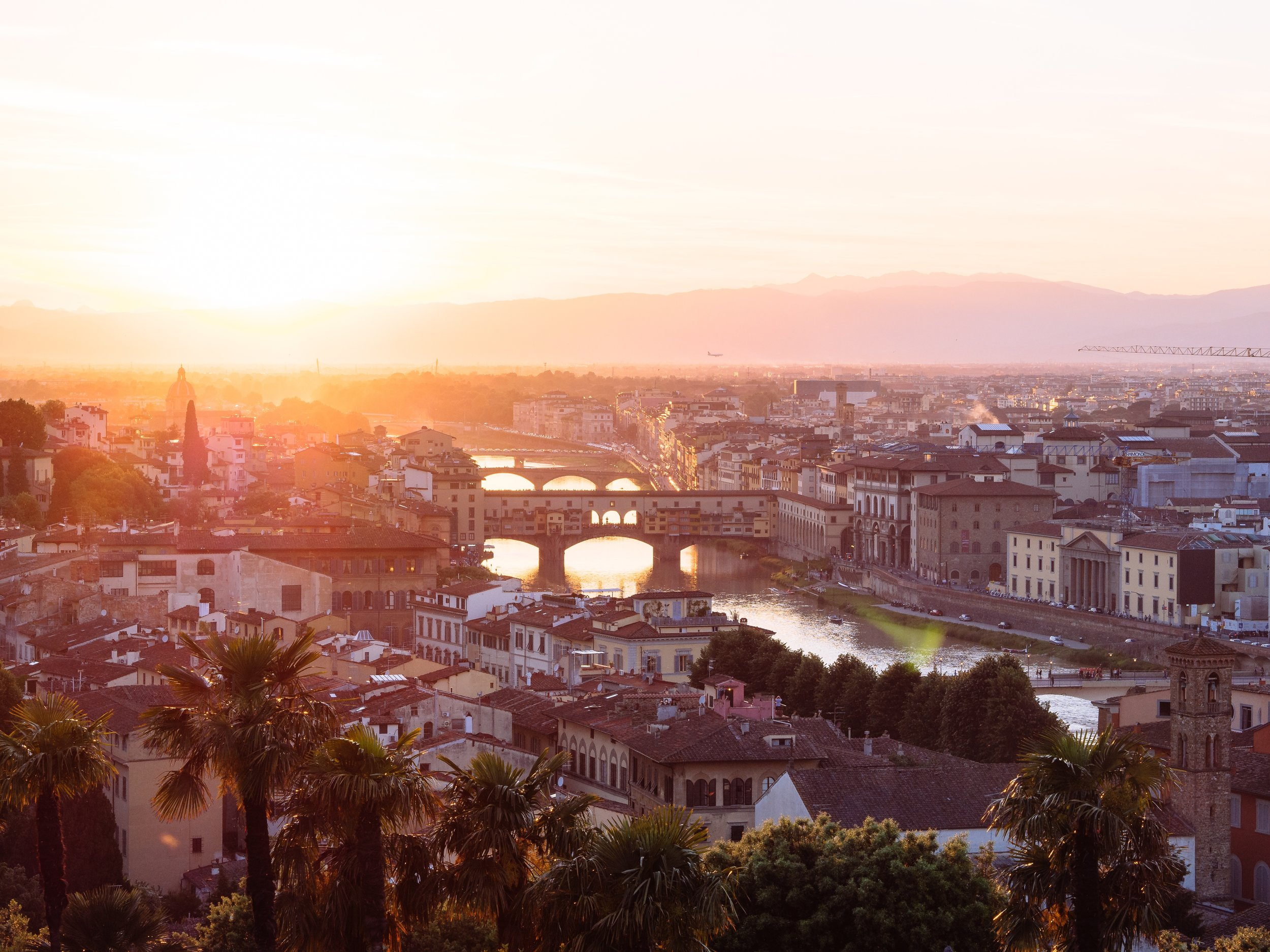 Grab a bottle of wine, sit on the steps of Piazza Michaelangelo and watch the sunset!