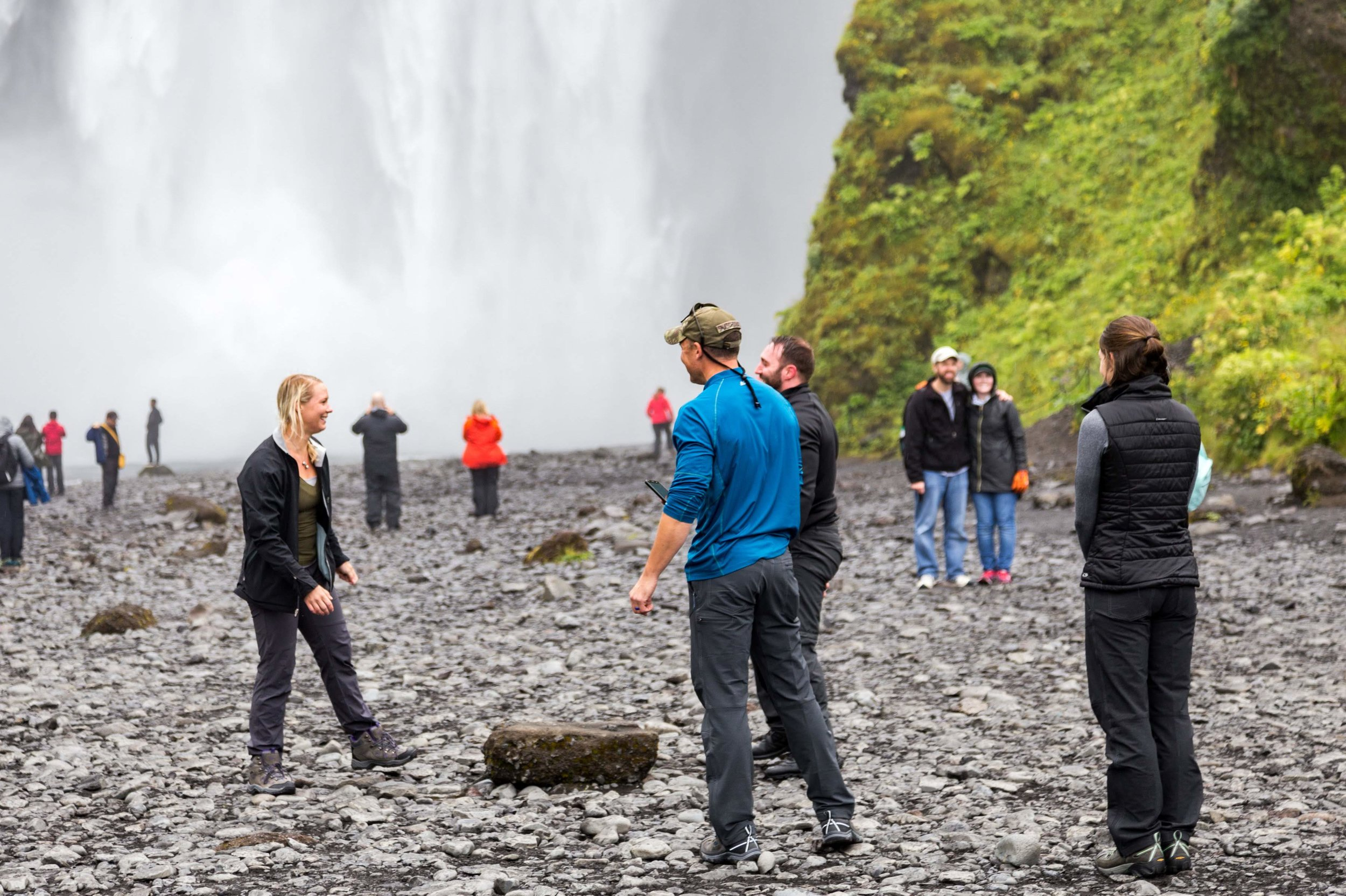 The group from 2018 beneath the massive Skógafoss Waterfall on the Southern Coast of Iceland