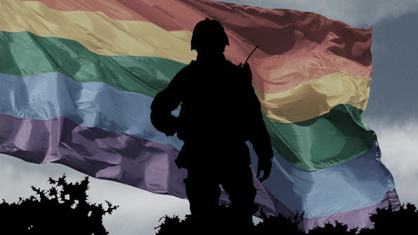We Demand An Apology Network - silouette of soldier in front on rainbow flag.jpg
