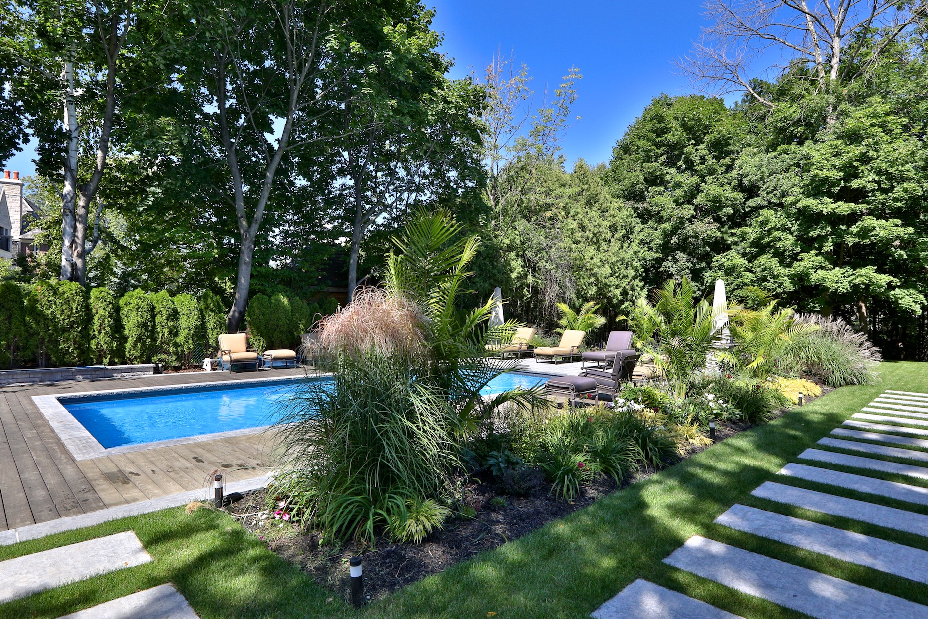 parkscape, landscaping, ipe decking, cedar hedge, stonework, pool, stepping stones, hydrangea, retaining wall, outdoor furniture