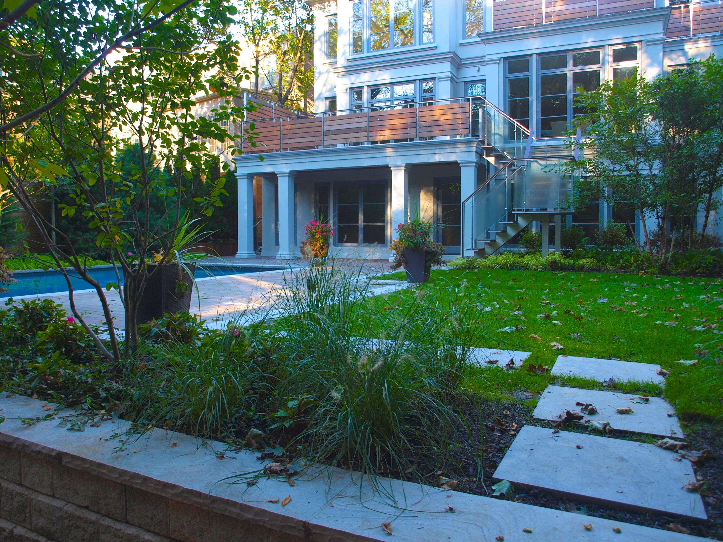 ipe decking, parkscape, custom, ornamental grasses, stepping stones, planting, betz pools, stonework, cedar fencing, glass railing, forest hill