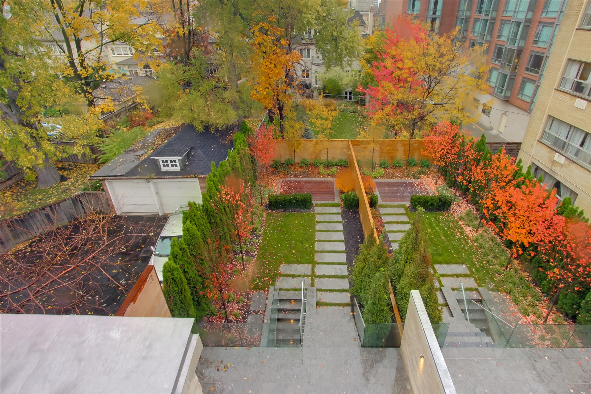 stepping stones, cedar hedge, yews, ipe decking, toronto, forest hill, maple trees, fall, leaves, stonework, parkscape