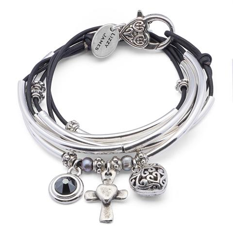 The Charmer with Heart Cross Charm Trio  is a 2 strand leather wrap bracelet that can also be worn as a necklace.