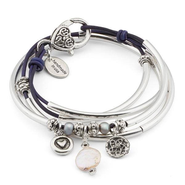 The  Mini Charmer with Pearl Charm Trio  wrap bracelet comes with the heart in circle charm, pearl charm, and yoga charm attached. Shown in natural purple leather.