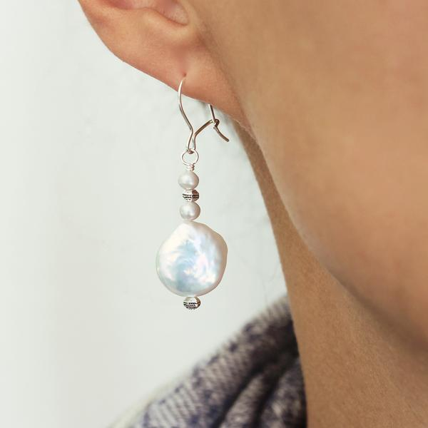 The  Pearl Grey Earrings  can brighten up any look.