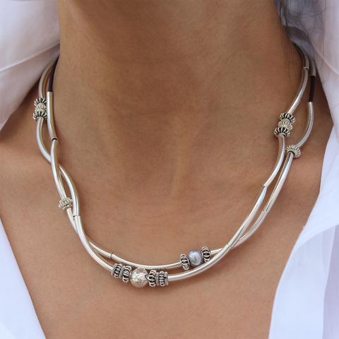 The  Double Heather  in Sterling Silver can be worn as necklace or bracelet.