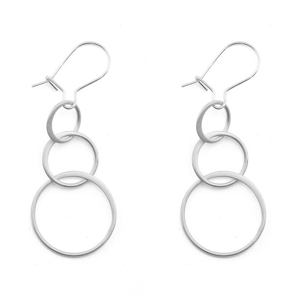 The  Echo Sterling Silver Earrings  features matte sterling silver linked rings.