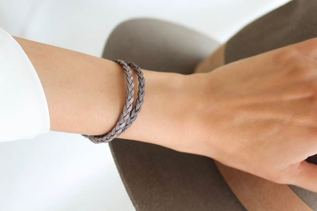 The  Nick with Stainless Steel Clasp  looking uniquely simple and sophisticated in natural grey braided leather.