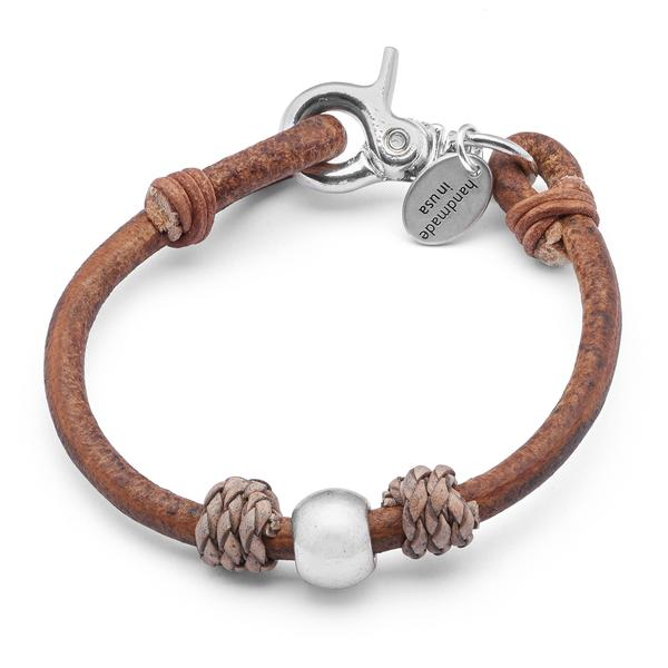 The  Dylan  wrap bracelet adorned with braided leather knots and gorgeous center bead.