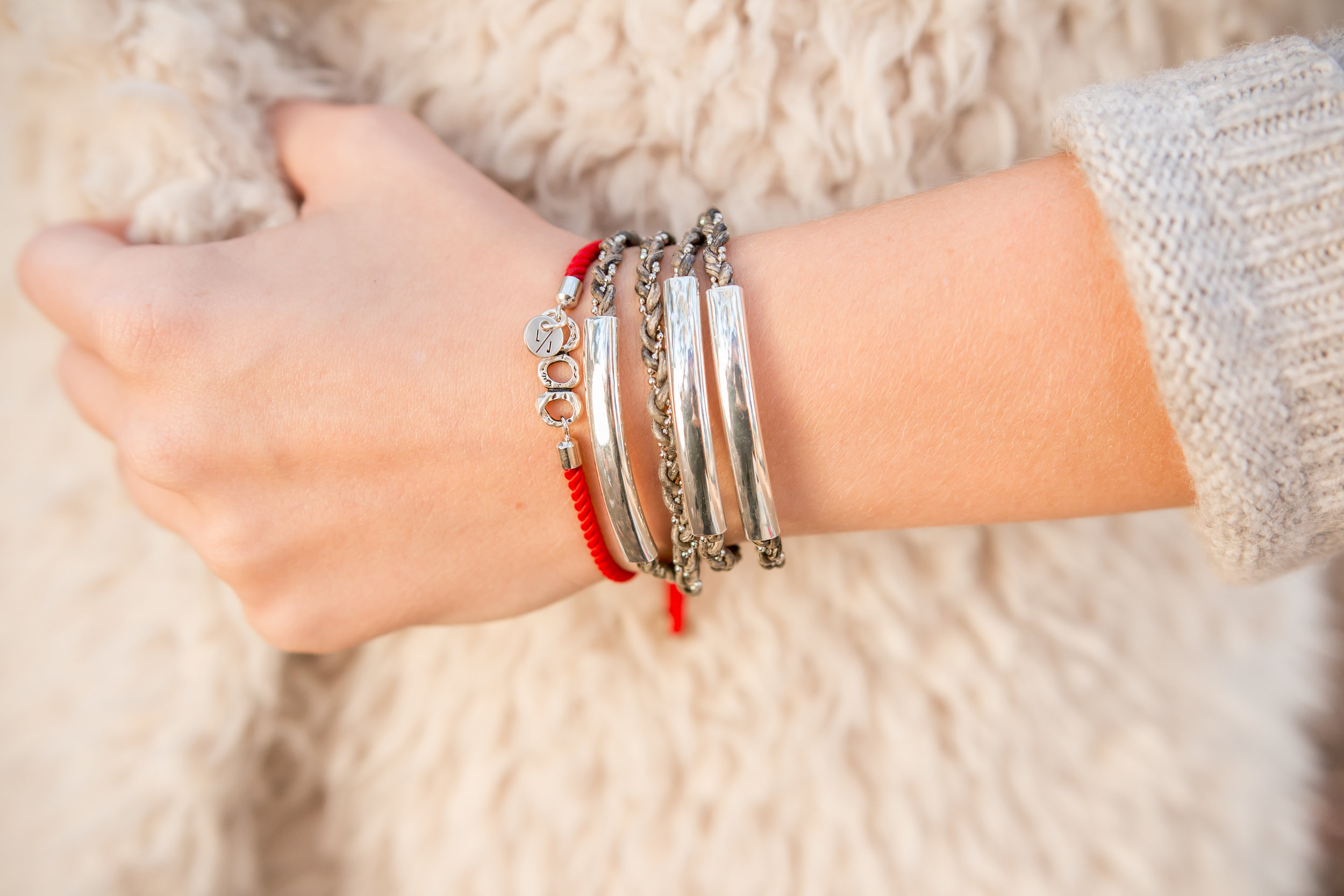 The  Rebecca Adjustable Bracelet  shown in Red stacked with the  Mini Mariah .