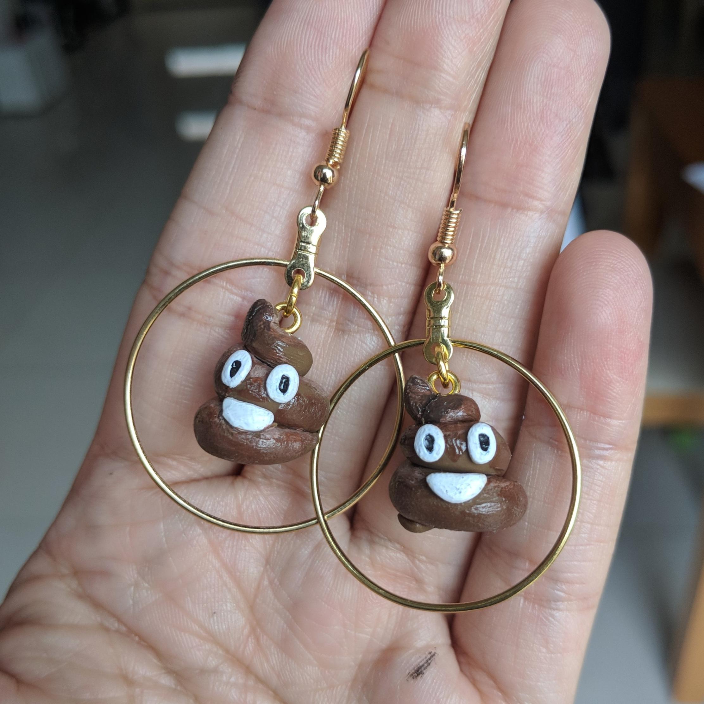 Cute Ring of Poop Power earrings I made for @littlepineneedle