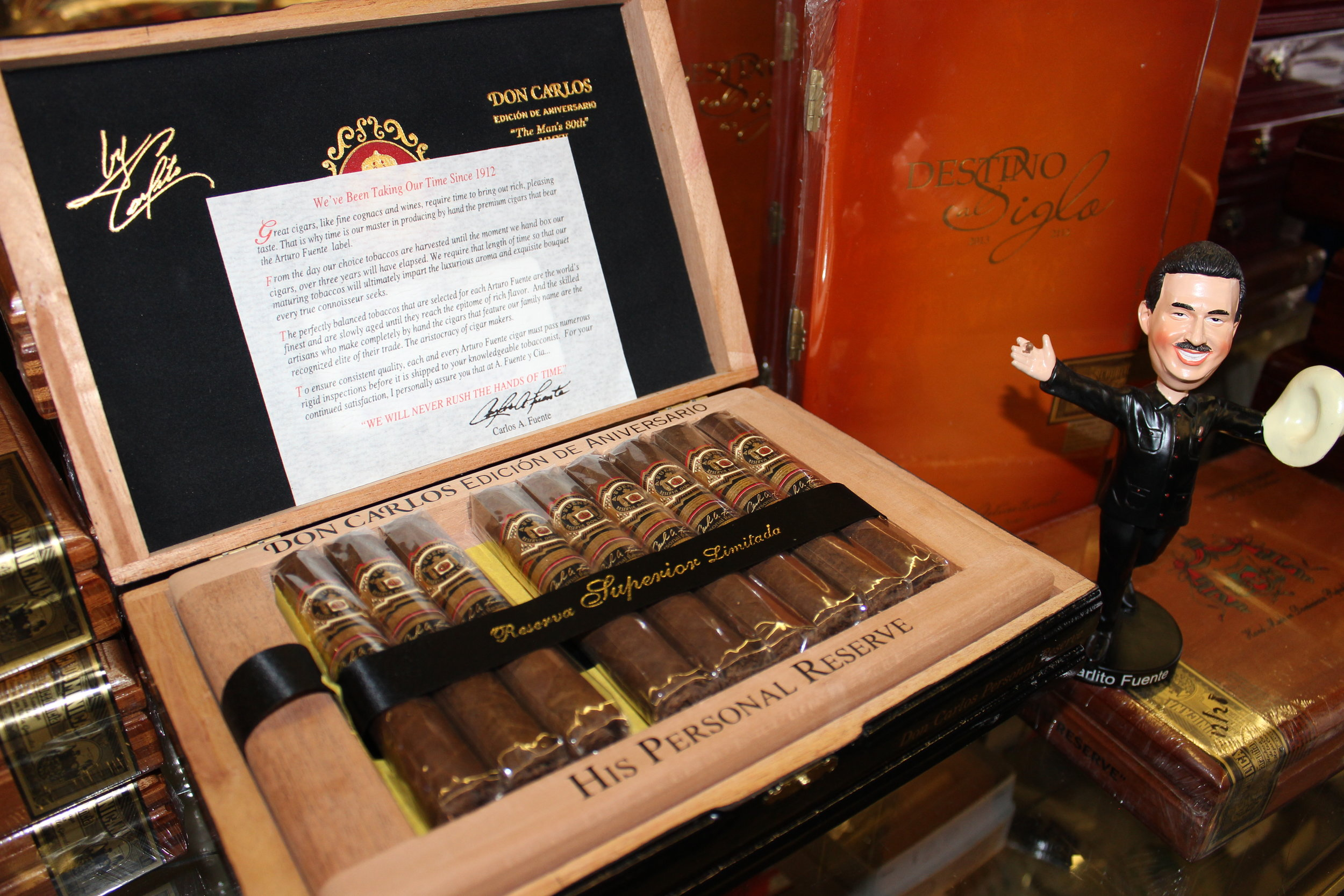 "The Fuente Don Carlos Personal Reserve, the Man's 80th: "" Don Carlos Fuente Sr. has always smoked a cigar made just for him at his factory. In 2015, to celebrate the 80th birthday of the patriarch, Tabacalera Fuente has released the private blend to the public in a limited edition called Don Carlos Personal Reserve. This Robusto cigar is packaged in glossy black boxes and includes a pair of white gloves."""