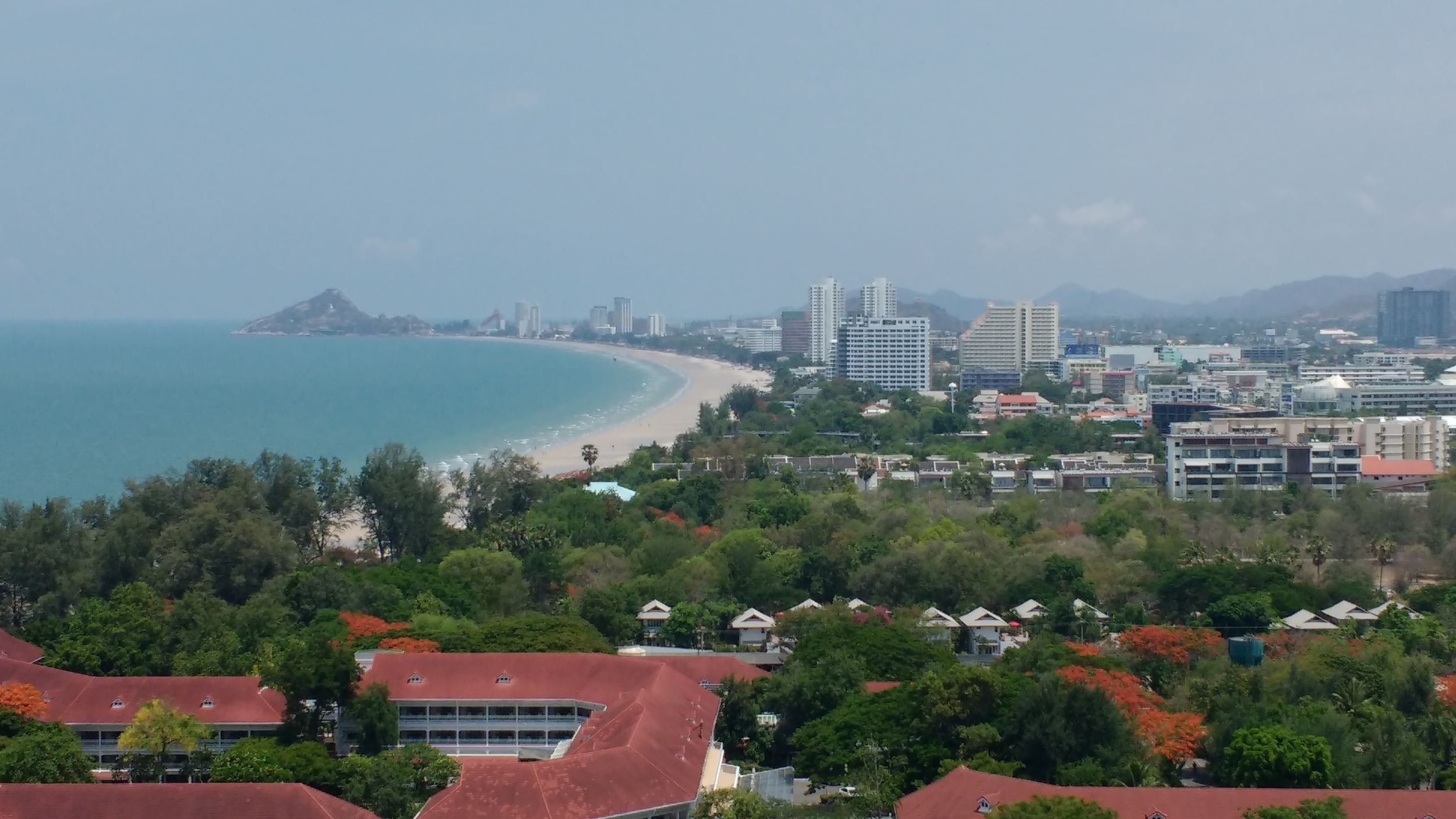 View south of Hua Hin from Hilton hotel. Khao Takieb is the rock at the end of the bay