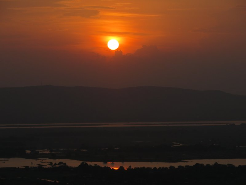 Sunset over the Irawaddy river from Mandalay Hill