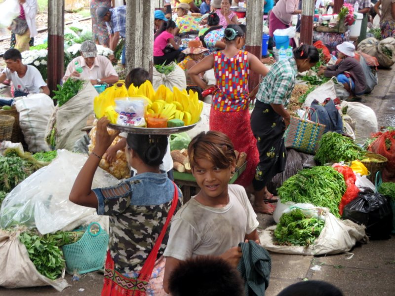 Busy market vendors at one stop on the circular train