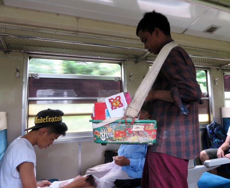 Vendor on the train selling Betel quid chewing tobacco. Iain declined to try it!