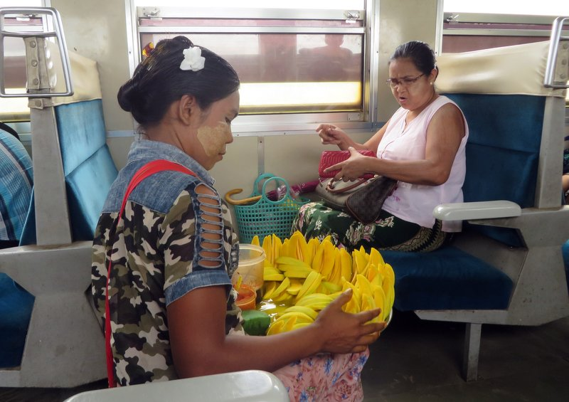 Mango vendors roam up and down the carriages selling their produce