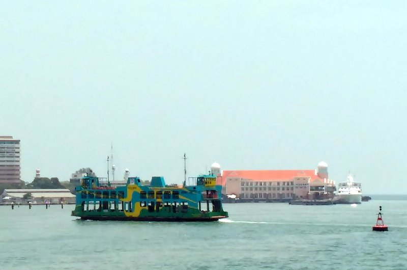 Passing the ferry in heading to Penang Island.