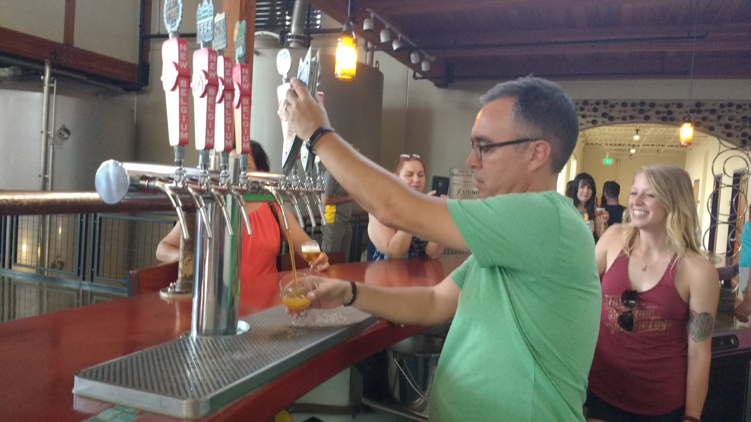 Iain pours himself a beer during the New Belgium Tour