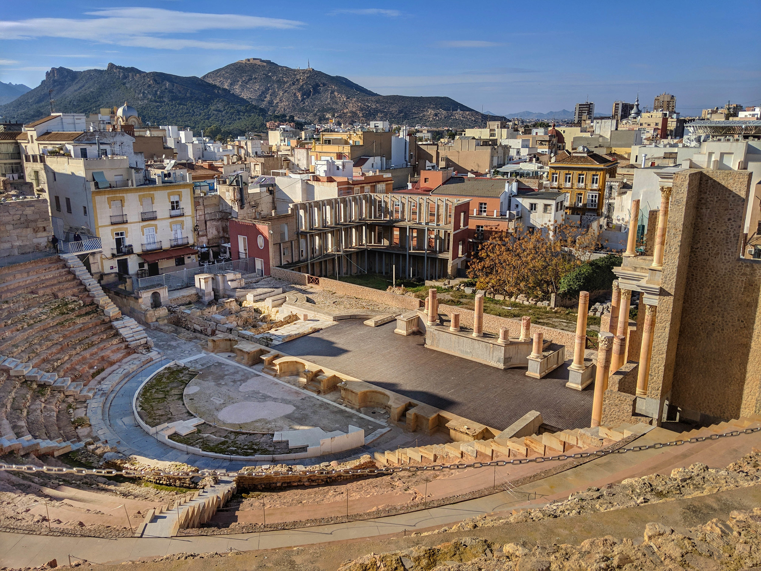 The Roman amphitheater nestled in the center of a modern city