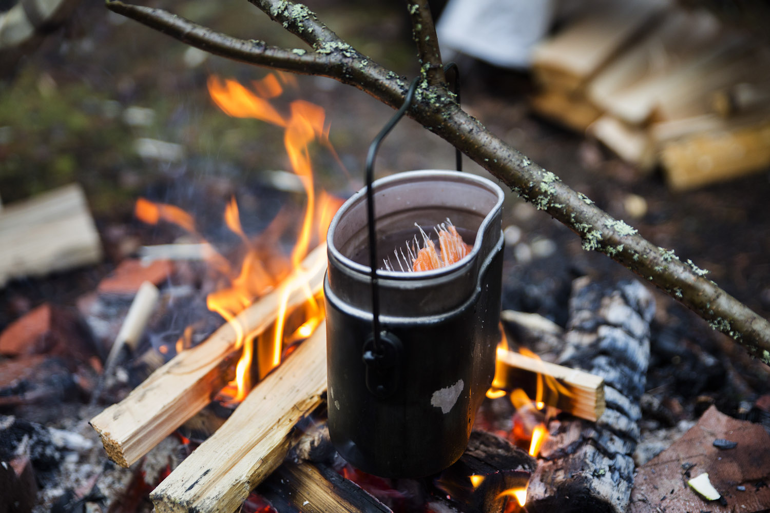 fish soup over an open fire