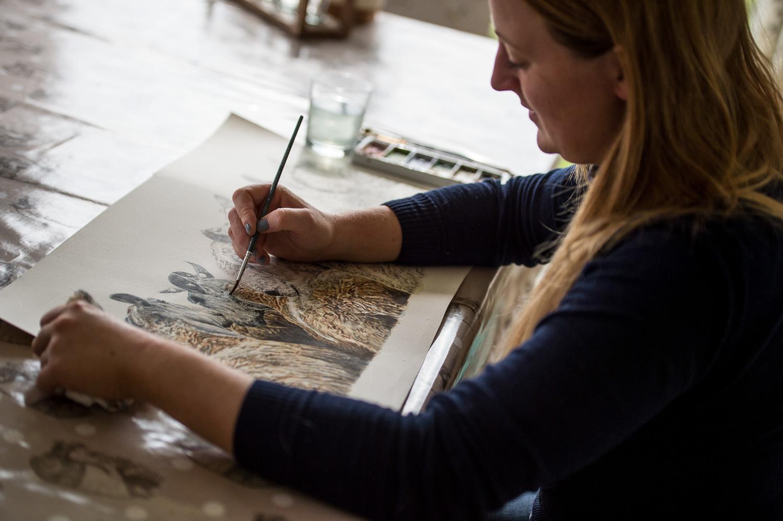 Artist Kate Simpson working in her studio