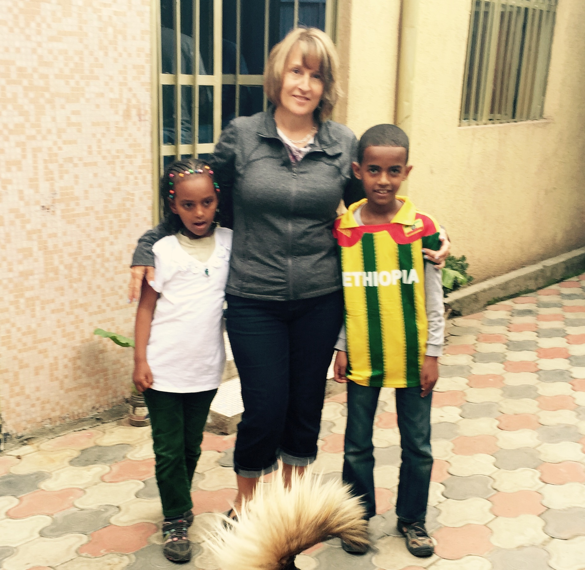 Longtime sponsor Carolyn Usher with her sponsored child, Yabi (right), and Mekdi, sister of Carolyn's daughter Lilly.