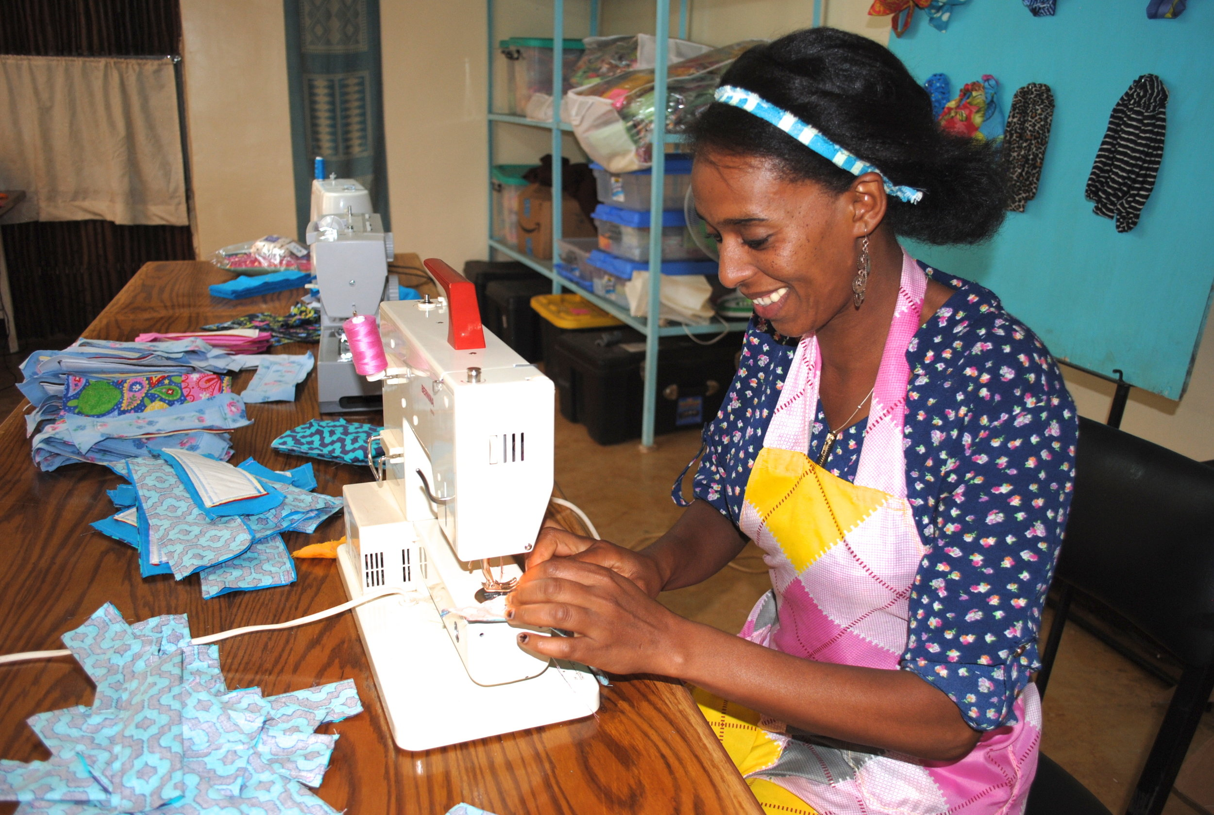 Serkalem sews a washable, reusable, affordable pad at the WRAPS facility in Wolaitta Village. She's one of six women employed by the project, which helps to keep girls in school by providing them with safe and sanitary pads to use when they have their menstrual periods.