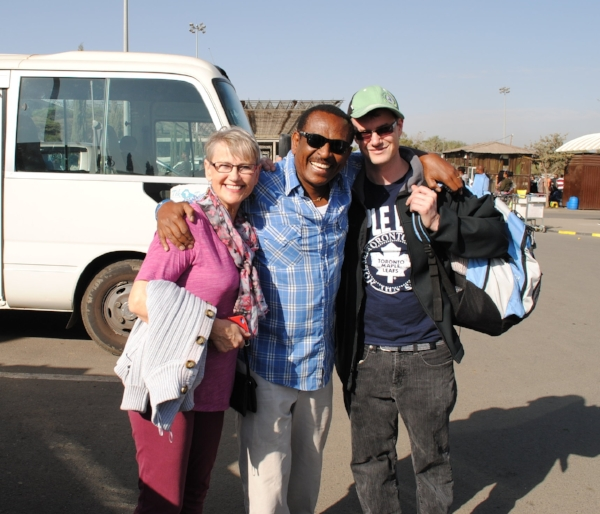 Val Easton, Gecho Wolde, and Kyle Easton at the airport on our trip to Ethiopia in February 2017. Look at those smiles!