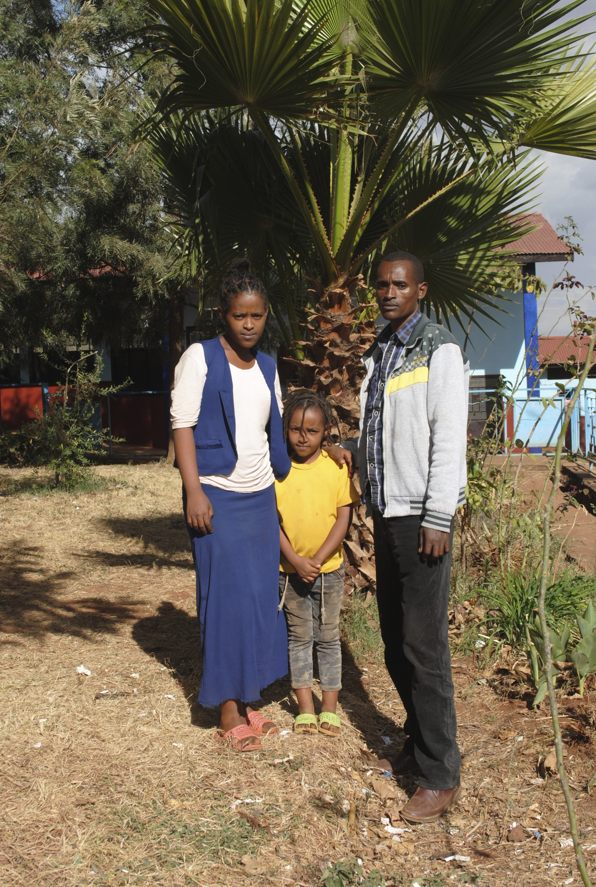 Wubalem, her father, and her sister Tiblet at Abba Pascal Girls School