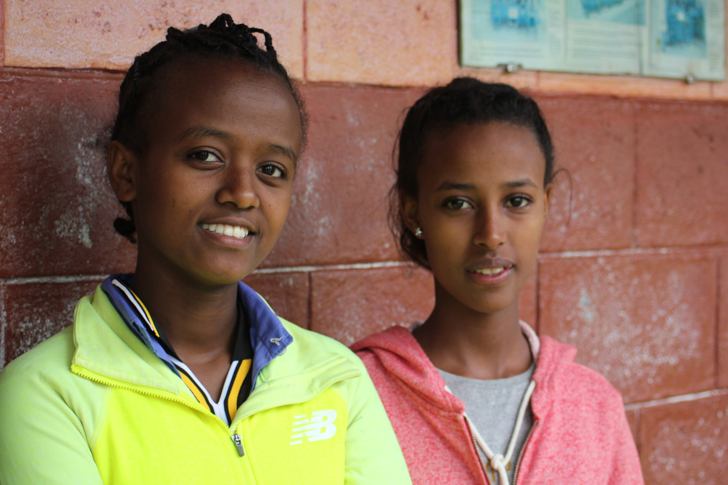 Yordanos (left) and Biruk (right), two young women who graduated after three years in the Girls Gotta Run program.