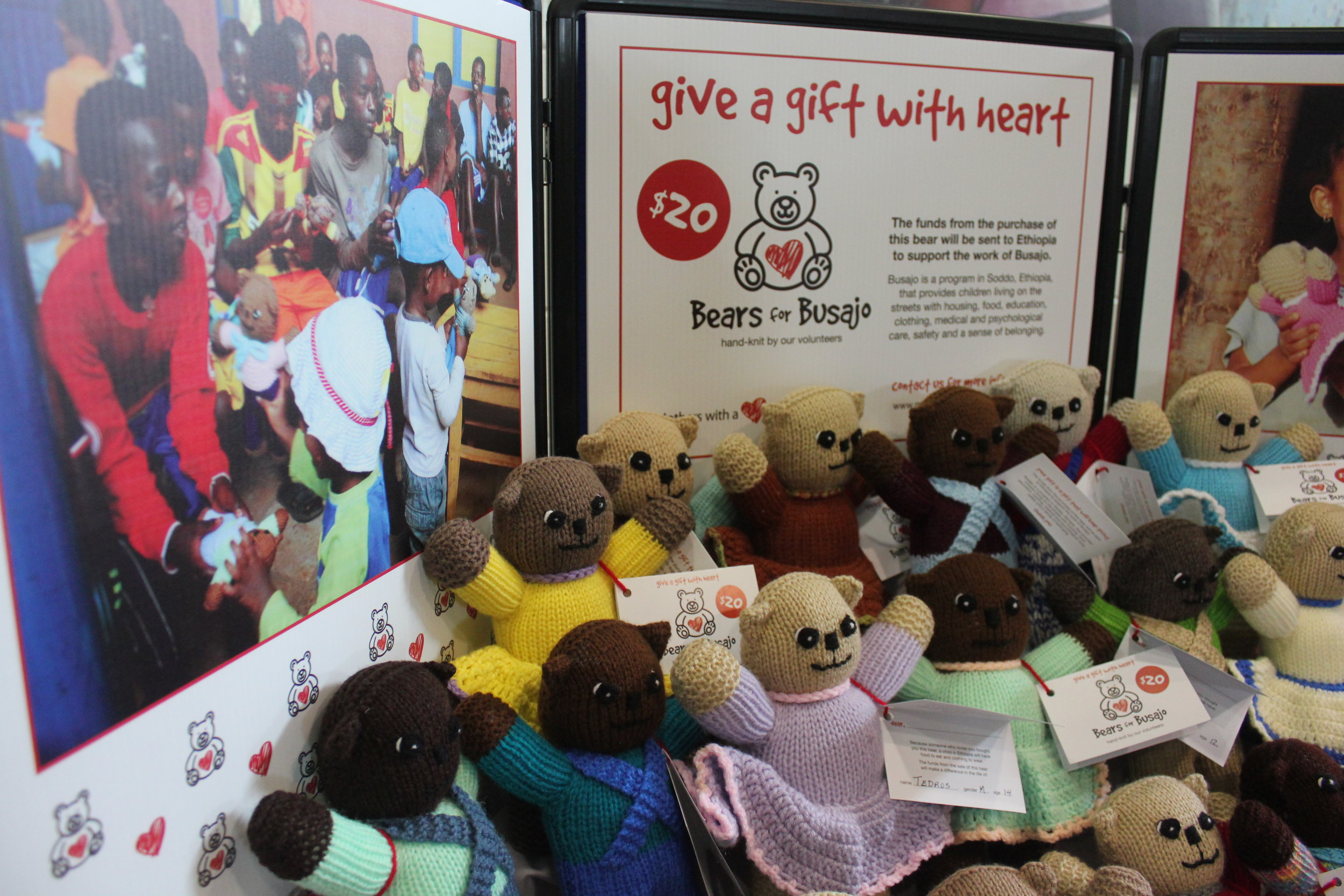 Our Bears with Busajo are hand-knit by a team of incredible volunteers. Proceeds go to support our work in Ethiopia. We also bring a number of these bears to hand out to children at our projects when we go to visit.
