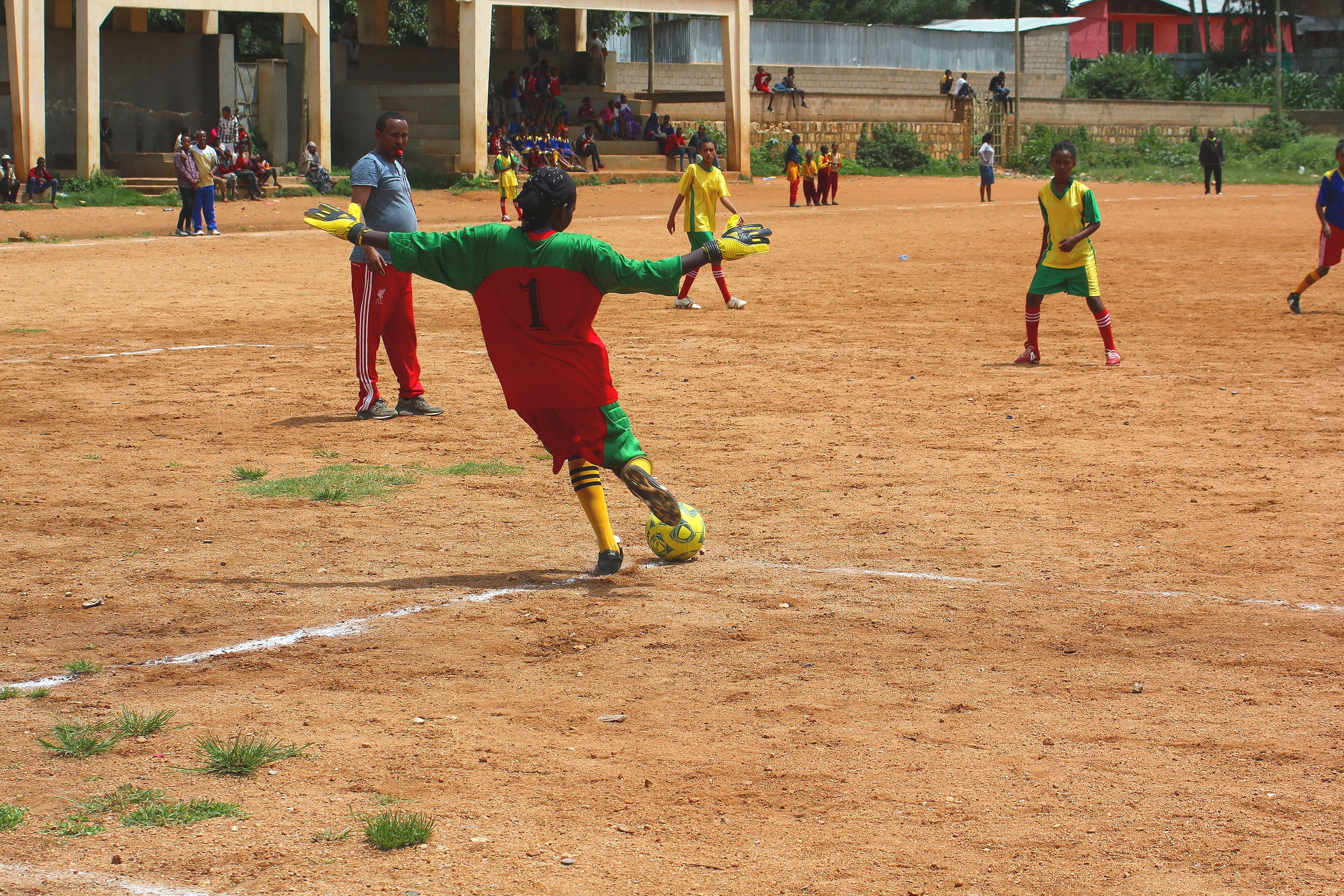 Eurgri (centre, #1) defends the goal during a soccer tournament in Harar in June 2018 between the two girls teams that receive funding from Mothers with a Heart for Ethiopia.