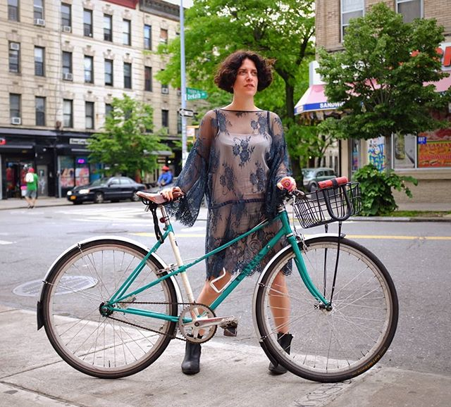 Zoë serving face, fashion, and fenders. Summer rainstorms ain't got anything on the #mixtefixie. 🌦️ . . . . . . #univega #stepthrough #mixte #fixedgear #womenwhowrench #vintagefashion #bikeswithbaskets #commuterbike #citybike #fenders #sks #womenwhoride #bikeshop #shoplife #bikelife #bikenyc #bushwick #brooklyn #nyc #havencycles #neverestablished