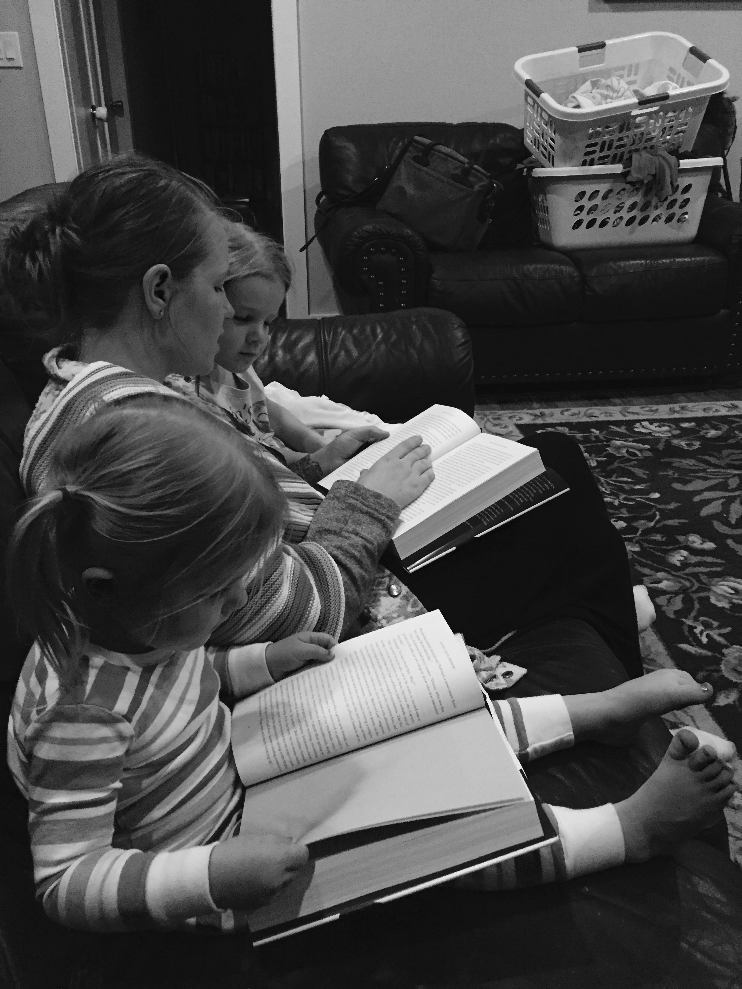 Reading PopPop's book to Eiley and Della before bedtime.