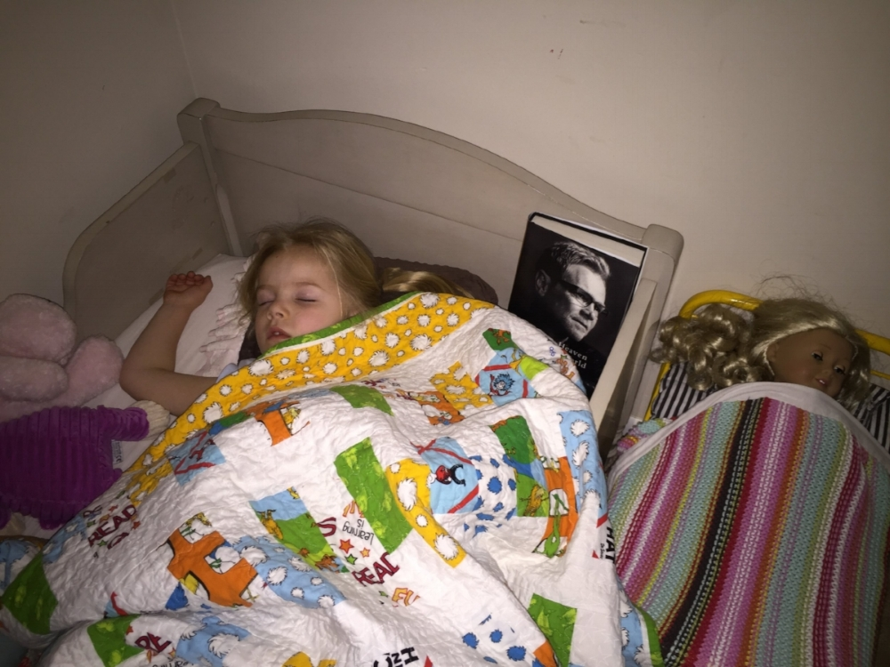 Eiley asked to sleep with PopPop's book the night she received it