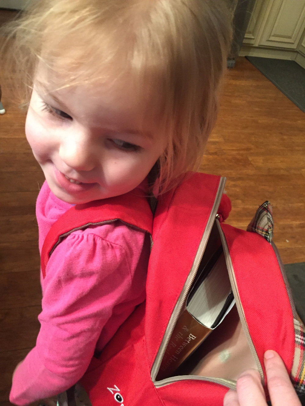 Della snuck her book to preschool the other day . . . she just couldn't put it down!