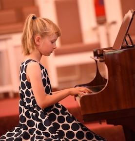 Alli plays at the New Mozart Summer Recital in June 2018