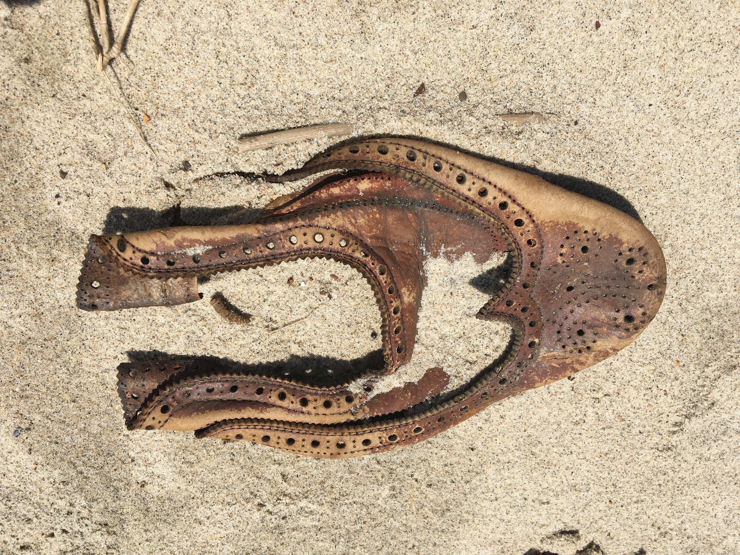 A shoe found in the sand - most likely dating back to the 1950s given the style and history of the bay.