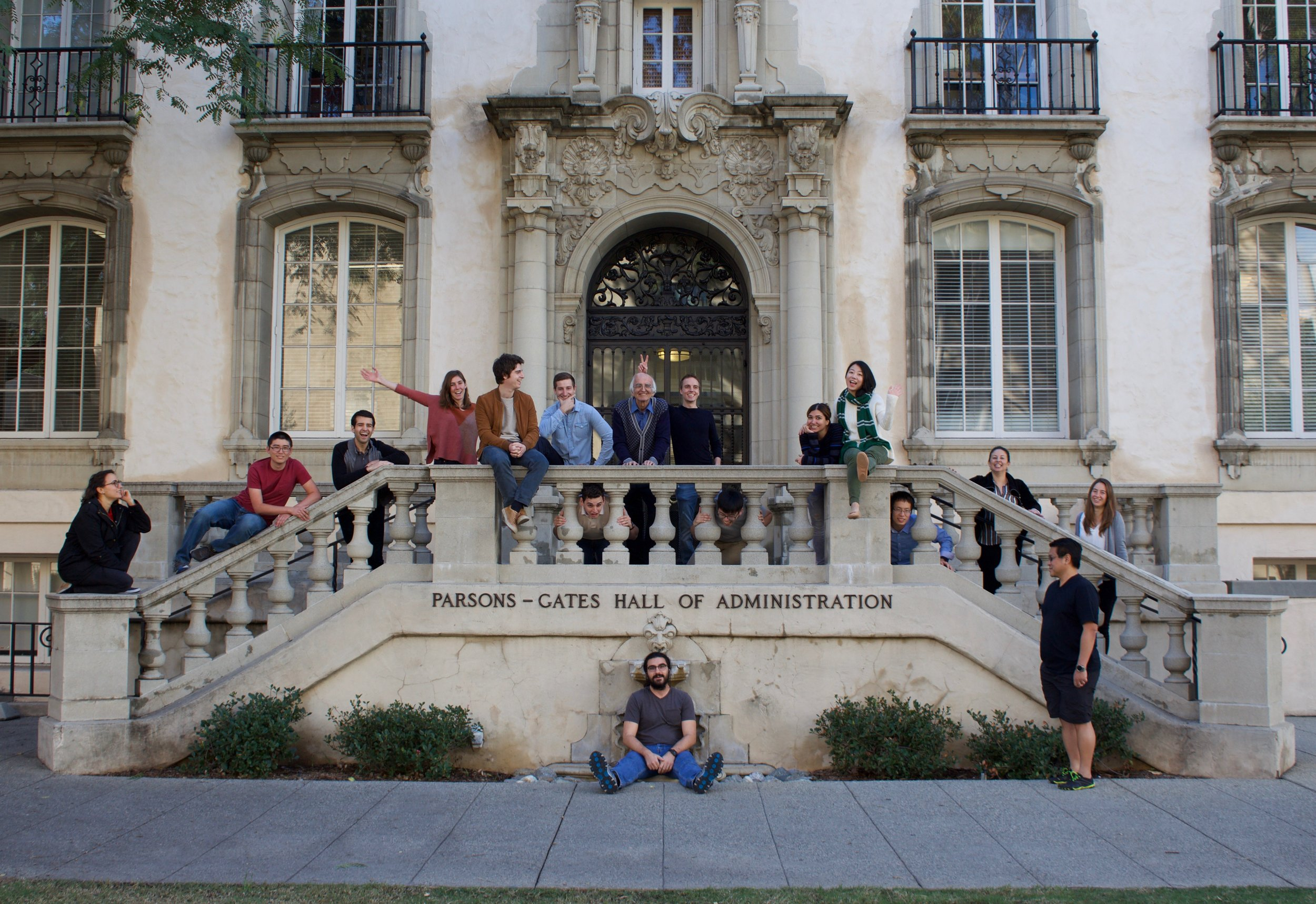 In front of Caltech's Hall of Administration!  Sitting on the floor: Manu. Staring at Manu: David J.Head between the balusters (left to right): Chris D., Chris R., and Cong. On the stairs (left to right): Morgane, Nathan, David M., Stephanie, Raimondo,Marcel, Masoud, Damian,Azin, Jinglin,Martha, Cecilia.  Photo credit: Kali Dougherty from Kali Jeane Photography.