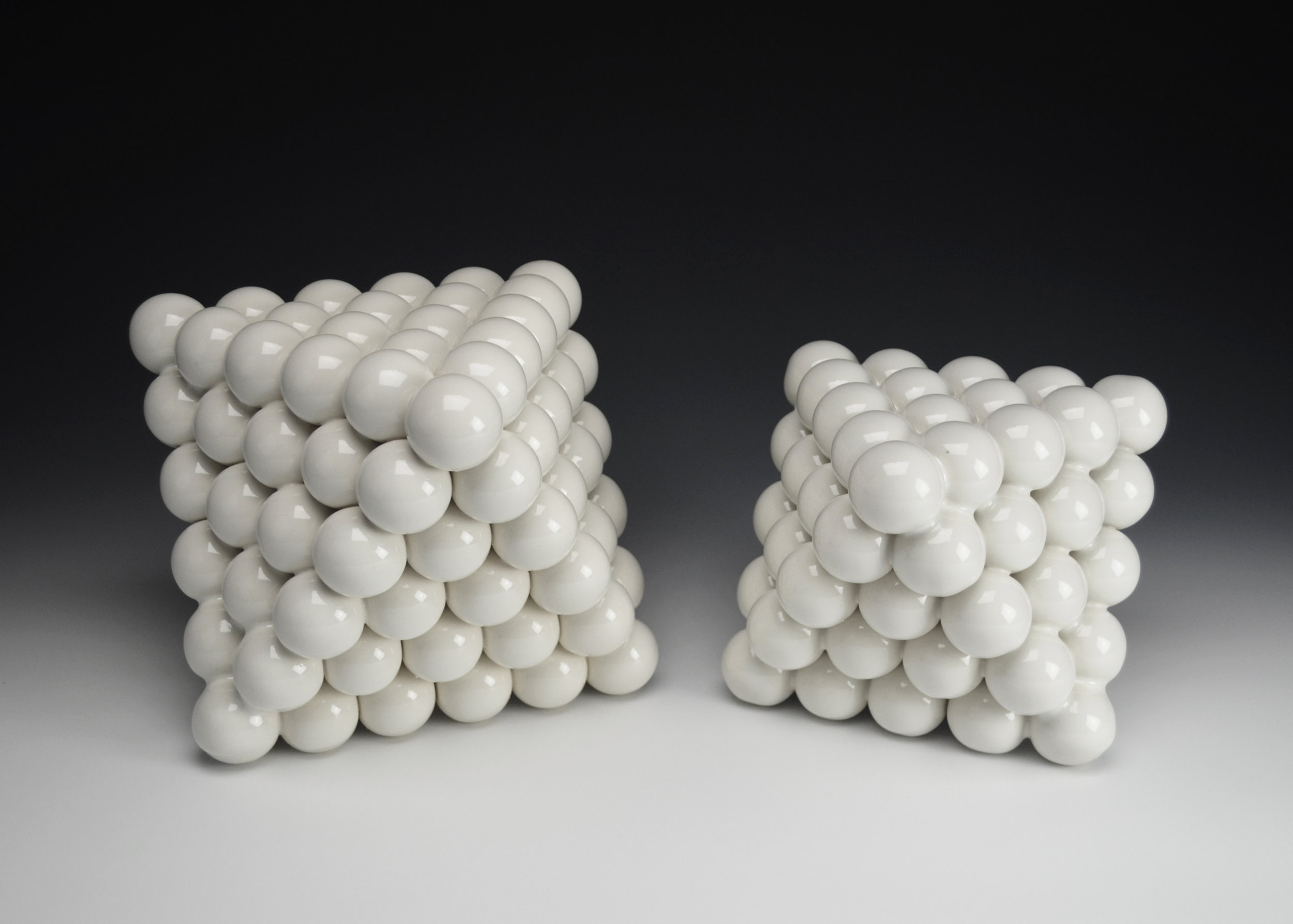 Ionic Series: Octahedrons  |  Left: 8 x 8 x 12 inches, Right:  6.5 x 6.5 x 9 inches  |  Porcelain, Glaze  |  2017