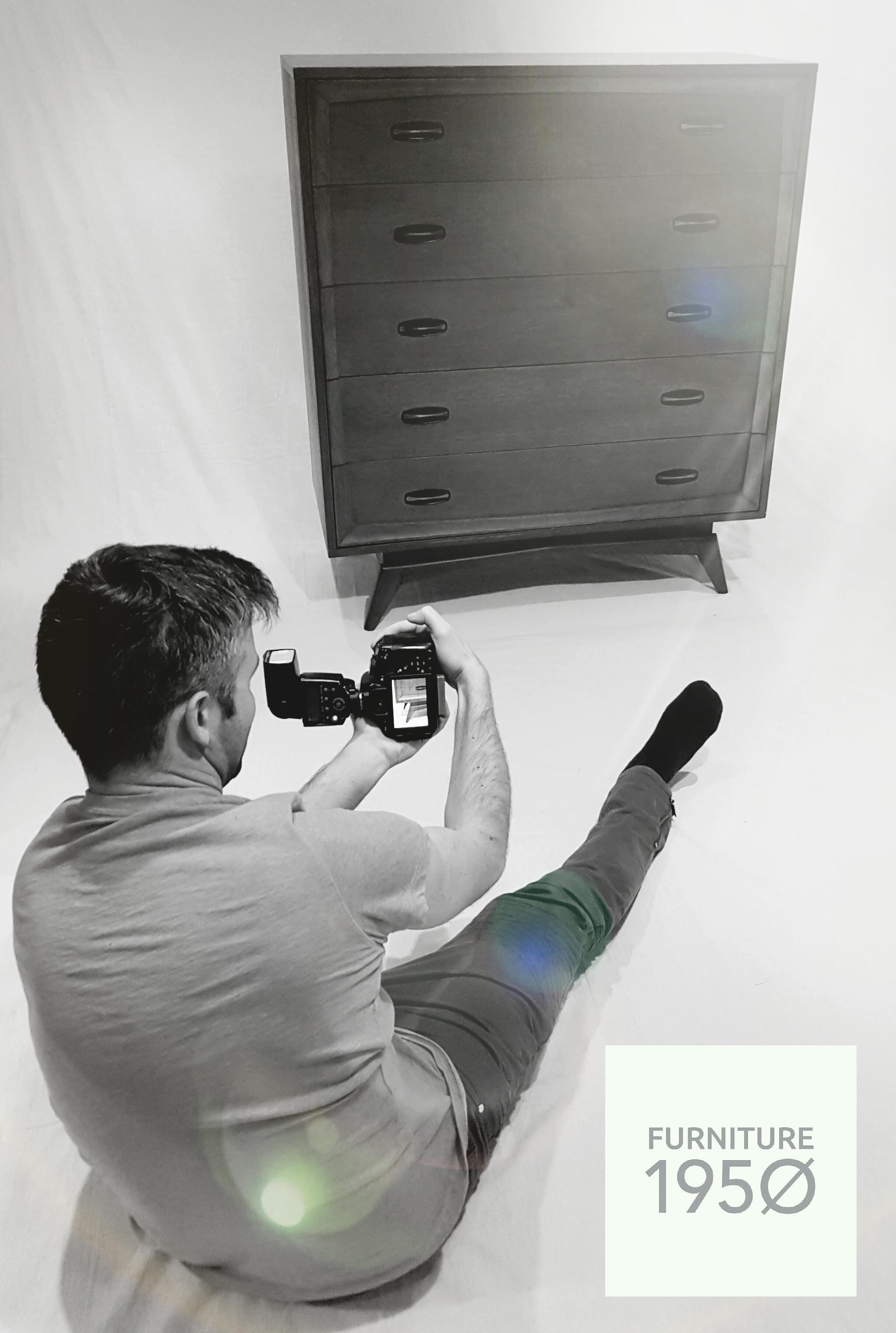 Jason photographing a mid century modern dresser