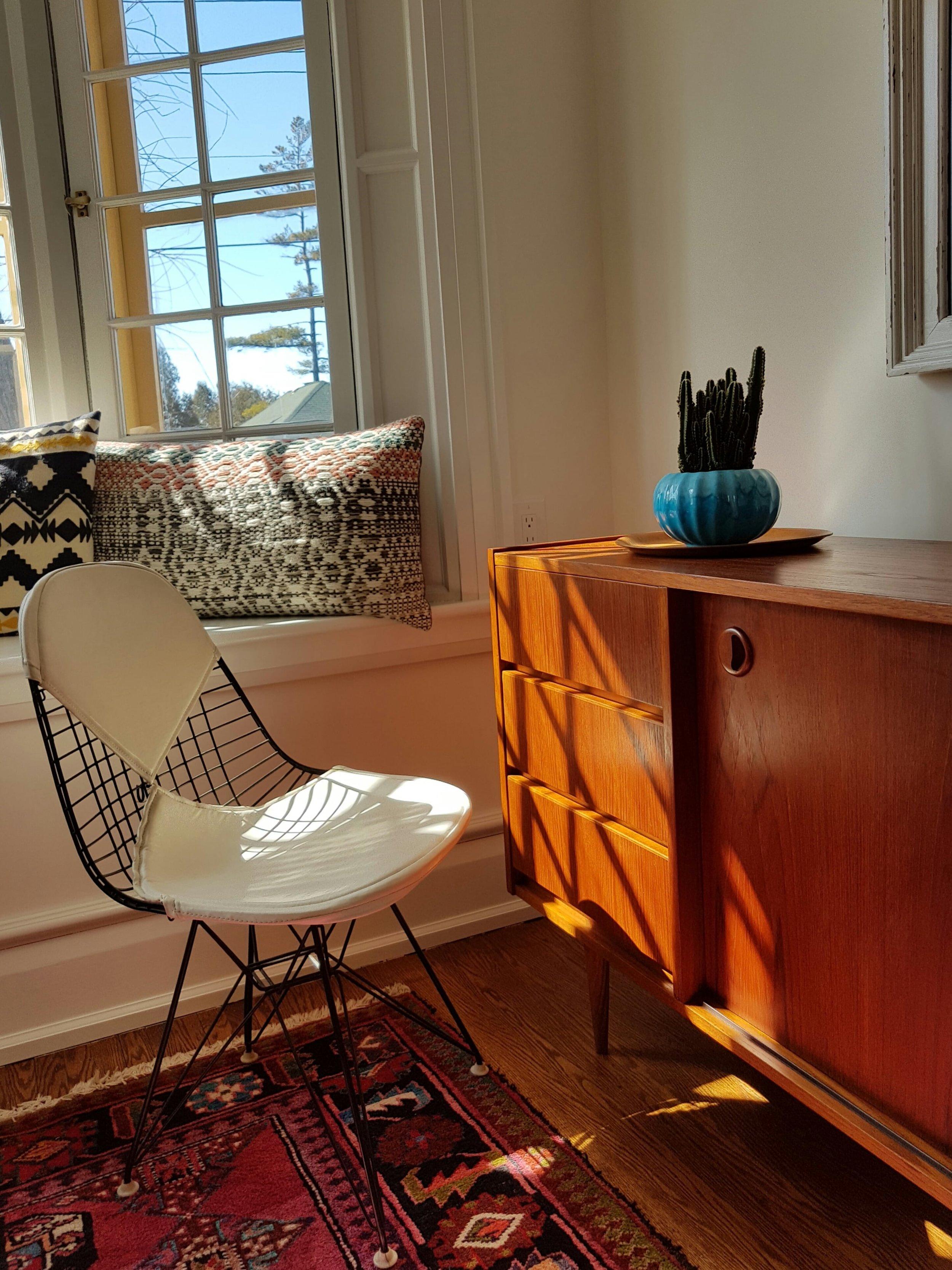 Furniture 1950 Mid Century Modern Teak credenza Herman Miller Eiffel Tower dining chair white.jpg