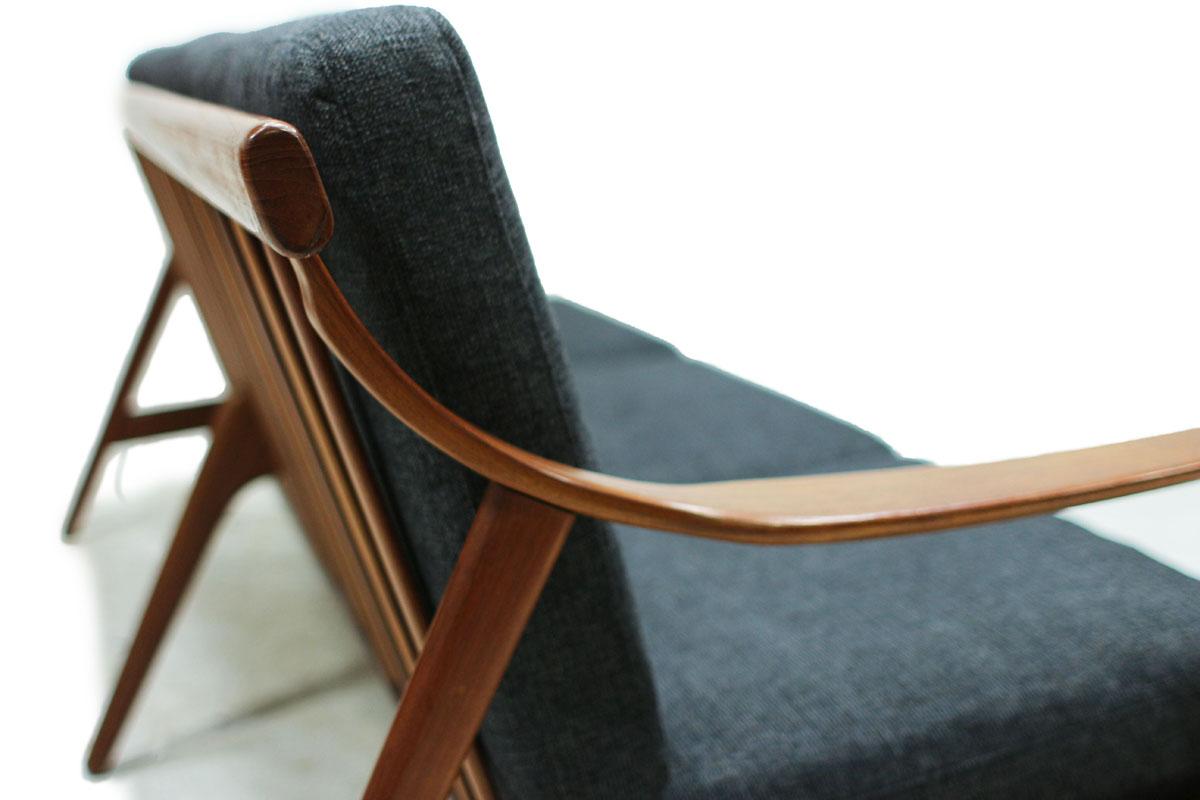 1960's Danish Designer MCM Teakwood Sofa with Sculpted Armrests and Dark Grey Cushions Designed by Arne Hovmand Olsen